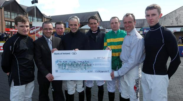 Richard Forristal, Irish Independent racing journalist presents a cheque to the injured jockeys fund, to jockeys, from l to r, Mark Enright, Andrew Lynch, Ruby Walsh, Davy Russell, Jamie Codd, robbie Power and Mark Walsh at the first day of racing at the Punchestown Racing Festival in Co. Kildare. Picture credit: Damien Eagers