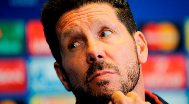 Atletico Madrid manager Diego Simeone in pensive mood during yesterday's press conference (Photo by Denis Doyle/Getty Images)