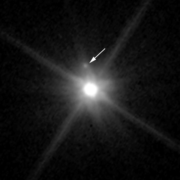 A small, dark moon orbiting Makemake, the second brightest icy dwarf planet, after Pluto, in the Kuiper Belt. (NASA via AP)