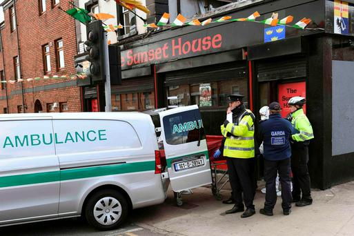 The body of Michael Barr is removed from the Sunset House. REUTERS/Clodagh Kilcoyne