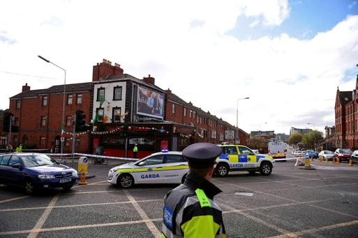 Police attend the scene of a shooting at the Sunset House pub in Summerhill, Dublin. It's understood senior gardaí are now 'extremely concerned' that the latest killing will lead to an escalation in violence. REUTERS/Clodagh Kilcoyne