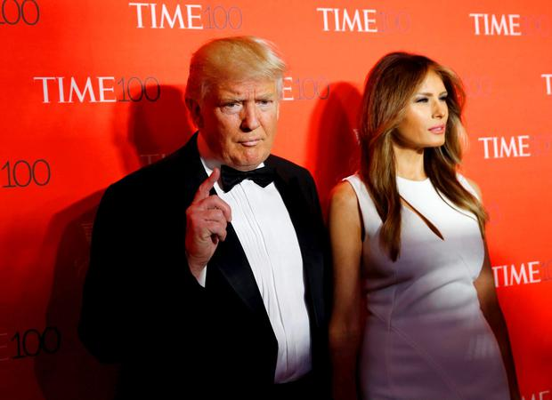 US Republican presidential candidate Donald Trump and his wife Melania pose for photographers on the red carpet as they arrive for the TIME 100 Gala in Manhattan, New York