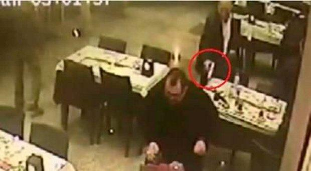 CCTV footage showing the moment allegedly showing the moment İdris Alakuş shot Hasan Erdemir