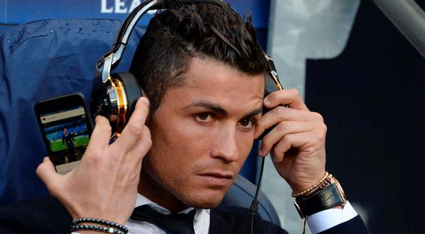 Ronaldo on the bench at Man City with a picture of himself on his phone