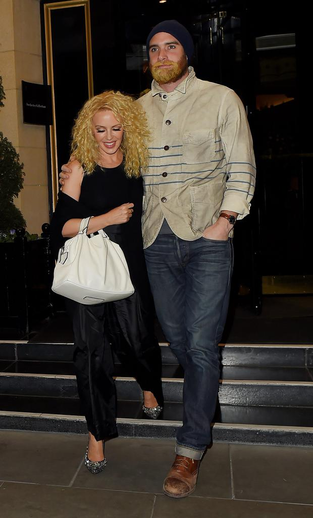 Kylie Minogue and Joshua Sasse leave The Dorchester Hotel before heading to The Wolseley restaurant in Mayfair on April 23, 2013 in London, England. (Photo by Keith Hewitt/GC Images)
