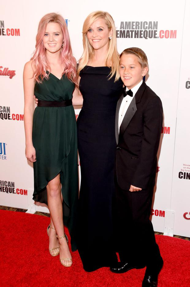 Actress Reese Witherspoon (C) gave birth to two of her children - Ava Phillippe (L) and Deacon Phillippe (R) - while she was in her twenties. (Photo by Jason Merritt/Getty Images)