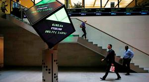 People walk through the lobby of the London Stock Exchange. Photo: Reuters
