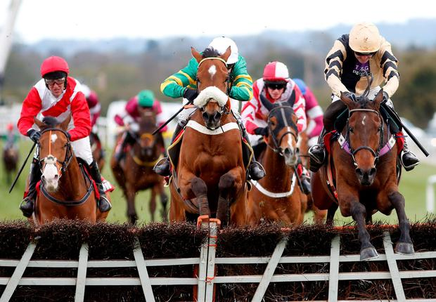 Bellhill, with Ruby Walsh up, clears the last on the way to winning the Novice Hurdle Photo: Alan Crowhurst/Getty Images