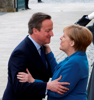German chancellor Angela Merkel greeting British prime minister David Cameron in Hannover this week. Photo: AP Photo/Michael Sohn