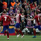 MADRID, SPAIN - APRIL 27: Saul Niguez (C), Koke (R) and Antoine Griezmann of Atletico Madrid celebrate scoring a goal during the UEFA Champions League semi final first leg match between Club Atletico de Madrid and FC Bayern Munich at Vincente Calderon on April 27, 2016 in Madrid, Spain. (Photo by Burak Akbulut/Anadolu Agency/Getty Images)
