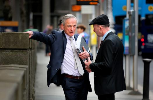 Acting Minister for Jobs Richard Bruton (left) and Independent TD Michael Healy Rae talk at Leinster House. Photo: Tom Burke
