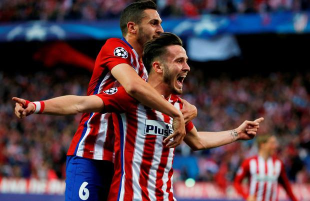 Saul Niguez celebrates with Koke after scoring for Atletico Madrid. Photo: Reuters