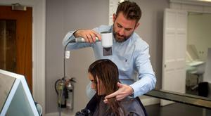 Eimear Rabbitte with Dylan Bradshaw and the new Dyson Hairdryer at his salon on South William Street, Dublin. Photo: Arthur Carron