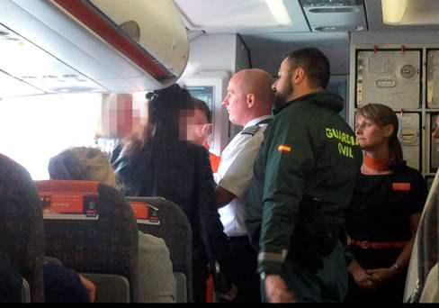 Two women escorted off plane by Spanish police