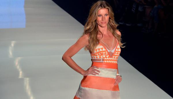 Brazilian supermodel Gisele Bundchen presents a creation by Colcci during the 2016 Summer collections of the Sao Paulo Fashion Week in Sao Paulo