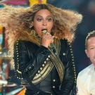 "(FILES) This file photo taken on February 7, 2016 shows Beyonce and Chris Martin as they perform during Super Bowl 50 between the Carolina Panthers and the Denver Broncos at Levi's Stadium in Santa Clara, California. Streaming site Tidal has soared in popularity since Beyonce released her latest album through the service as an exclusive, although she made it available on iTunes as well on April 25, 2016. The pop superstar late Saturday released her sixth album, ""Lemonade,"" which was accompanied by a film broadcast on HBO but whose album was initially only accessible to subscribers of Tidal. / AFP PHOTO / TIMOTHY A. CLARYTIMOTHY A. CLARY/AFP/Getty Images"