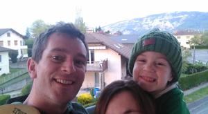 4 year old Joshua Gaughran with his Papa Patrick and Maman Myriam with on his balcony with the French alps in the back ground