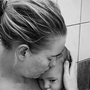 Kelli Bannister comforts her sick baby, Summer, in the shower. Photo: Kelli Bannister / Facebook