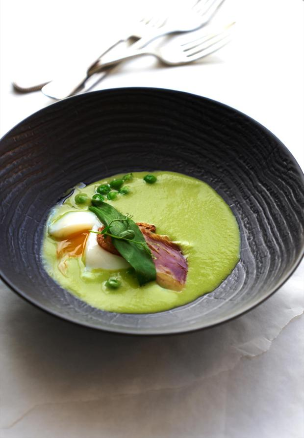 The yolk of the soft poached egg, with asparagus velouté and Iberico ham. Photo captured using a Sony α7R II. Photographer: Hugh Johnson. Location: Searcys at The Gherkin, London
