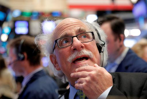 Trader Peter Tuchman works on the floor of the New York Stock Exchange (NYSE). Photo: Reuters