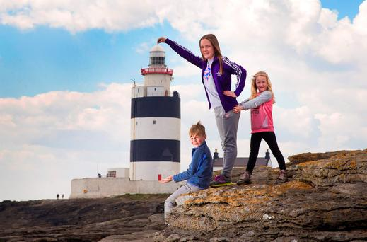 Ryan (7), Molly (9) and Ava Lynch (6) helping to launch the new Ireland's Ancient East Tour experience at Hook Lighthouse in Co Wexford. Photo: Patrick Browne