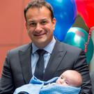 Leo Varadkar holds 2-month-old Jace O'Rourke from Kildare at an event to mark An Bord Pleanála's granting of planning permission for the new children's hospital on a campus shared with St James's Hospital. Photo: Mark Condren