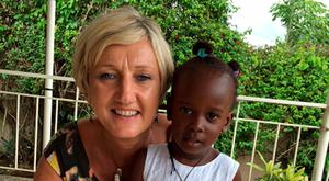Christening celebration: Miriam with her god-daughter Pearl in Uganda.