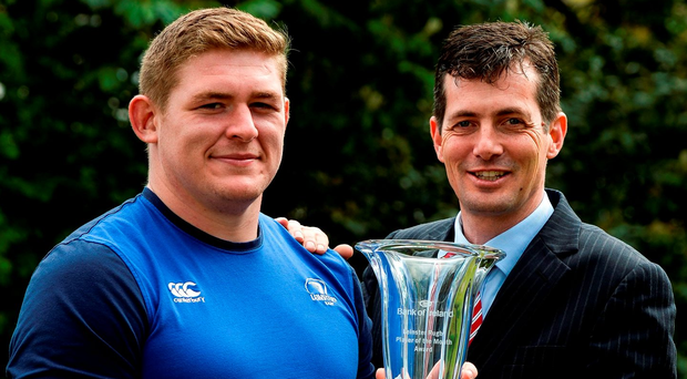 Tadhg Furlong is presented with the Bank of Ireland Leinster Rugby Player of the Month award for February/March by Donal Atkins, Relationships Manager at Banking at Work, Bank of Ireland in Belfield this week (SPORTSFILE)