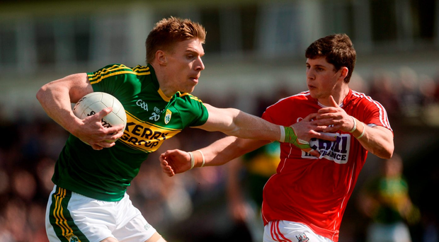 Tommy Walsh is pictured holding off Cork's Kevin Crowley in Austin Stack Park earlier this month, which was his last appearance for Kerry and, below, lining out for Ireland in the International Rules against Australia Photo: Sportsfile