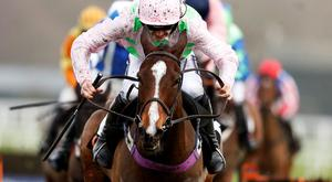 Ruby Walsh riding Vroum Vroum Mag clear the last to win The OLBG.com Mares' Hurdle Race at Ascot Photo: Getty