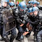 A protestor is arrested by riot police during a protest against the proposed changes to France's working week and layoff practices, in Lyon, central France