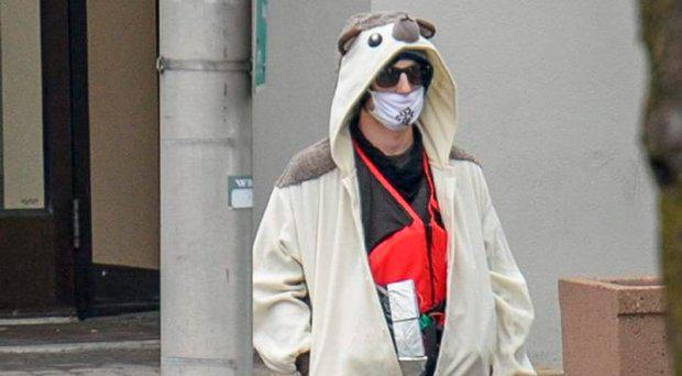 The man wore a full-body animal costume with something taped to his body