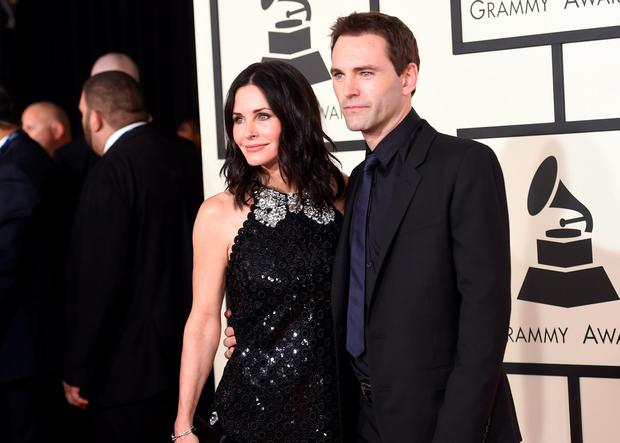 Actress Courteney Cox (L) and songwriter Johnny McDaid attend The 57th Annual GRAMMY Awards at the STAPLES Center on February 8, 2015 in Los Angeles, California. (Photo by Jason Merritt/Getty Images)