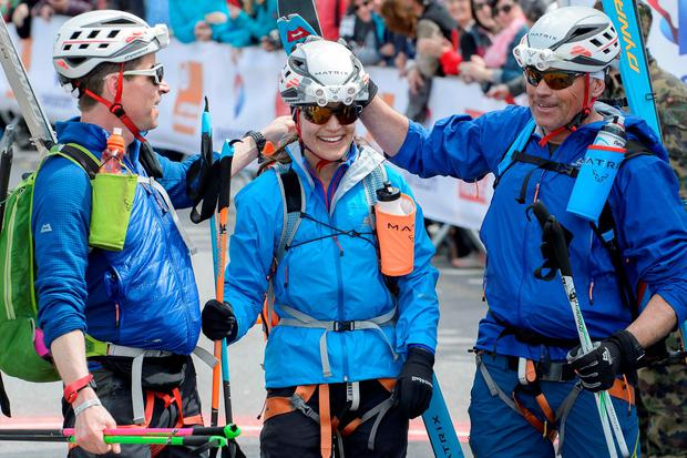 (L to R) Tarquin Cooper, Pippa Middleton, and Bernie Shrosbree react in the finish area of the Glacier Patrol race from Zermatt, in Verbier, Switzerland
