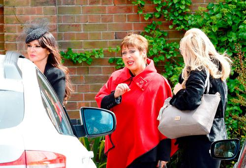 Lizzie Cundy (left) and Denise Welch (centre) arriving at Golders Green Crematorium in north London for the funeral of David Gest. Photo: John Stillwell/PA Wire