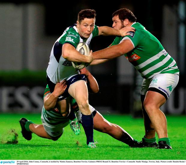 John Cooney, Connacht, is tackled by Matteo Zanusso, Benetton Treviso