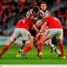 Ross Ford, Edinburgh, is tackled by Tommy O'Donnell, left and Niall Scannell, right, Munster