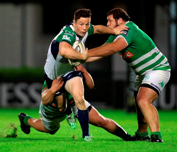 John Cooney, Connacht, is tackled by Matteo Zanusso. Photo: Sportsfile