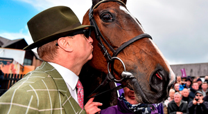 A kiss for the lady as owner Rich Ricci celebrates the victory of his mare Vroum Vroum Mag in the Betdaq Punchestown Champion Hurdle (SPORTSFILE)