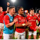 Munster players including Robin Copeland, Ian Keatley, Francis Saili, Johnny Holland and Jack O'Donoghue celebrate
