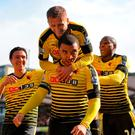 Watford's Troy Deeney (centre) celebrates scoring his side's third goal