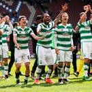 Celtic players celebrate beating Hearts and all but winning the Ladbrokes Scottish Premiership