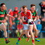 Ronan O'Toole, Cork, in action against Stephen Coen, left, and Fergal Boland, Mayo