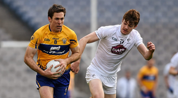 Clare's Gary Brennan in action against Kildare's Kevin Feely during the Allianz Football League, Division 3, Final at Croke Park. Photo: Ray McManus / Sportsfile
