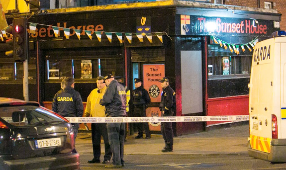 Members of the Gardai attend the scene of the shooting of Michael Barr at the Sunset House Pub in Ballybough, Dublin. Photo: Gareth Chaney Collins