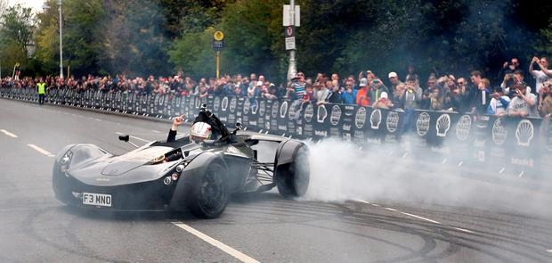 Professional LeMans driver Ollie Webb in a BAC Mono car on Merrion square as cars gather for the race. Photo: Gerry Mooney
