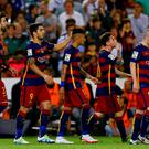 Barcelona's Luis Suarez (2nd L) celebrates with team mates after scoring