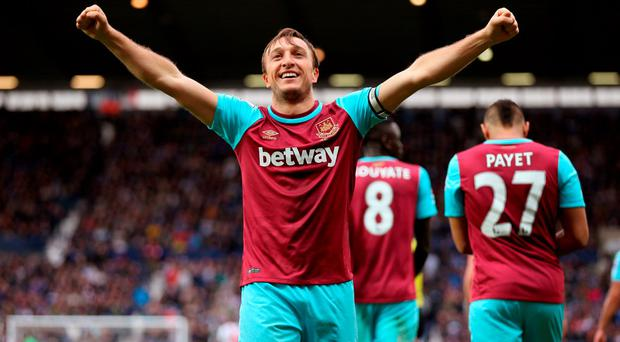 West Ham captain Mark Noble celebrates scoring his team's third goal. Photo: Getty
