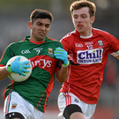May's Shairoze Akram in action against Cork's Ryan Harkin at Cusack Park. Photo: Seb Daly / Sportsfile