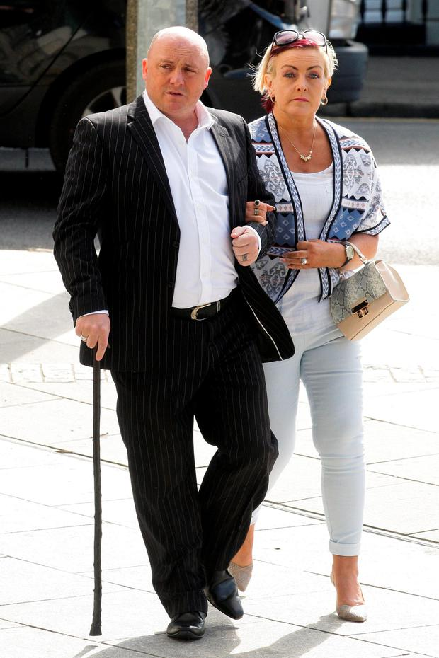 STANDING BY HER MAN: David Mahon pictured arriving at the Central Criminal Court in Dublin with his wife Audrey where he is on trial charged with the murder of Audrey's son, Dean Fitzpatrick, in 2013. Photo: Collins